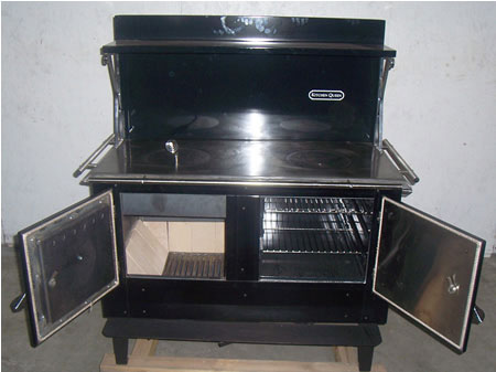 Shown with firebox (left) and oven doors open - Kitchen Queen 480 Wood Cookstove